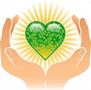 Hands holding earth heart